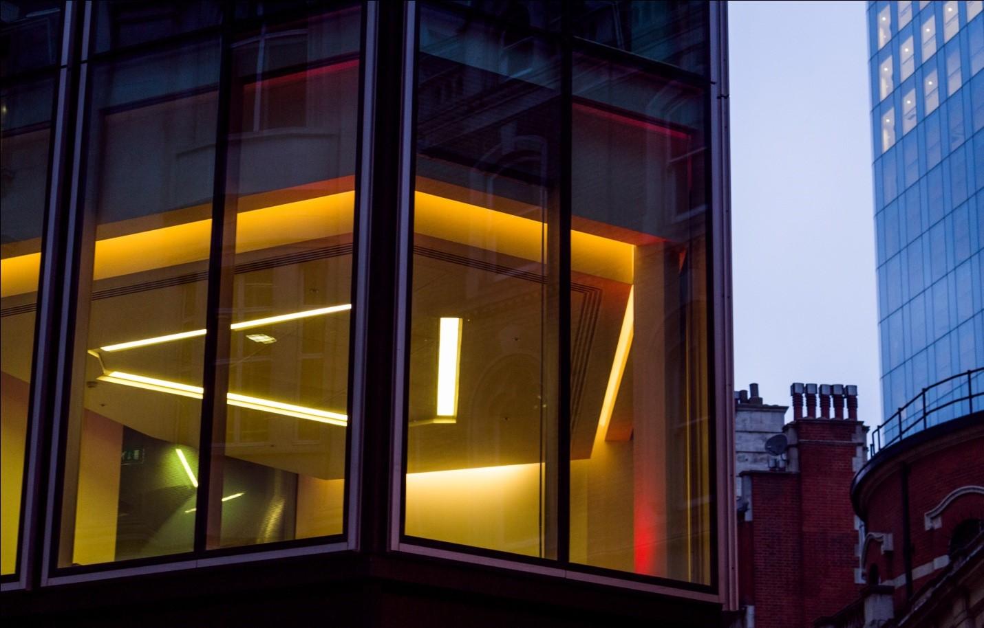Light fixtures showing through an office window